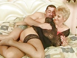 Grandma with fishnet stockings gets boned