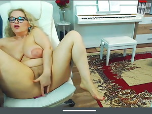 Ash-blonde mature with big saggy tits shows pussy and masturbates