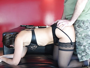 Cougar in leather underwear sucks big trunk and gets fucked