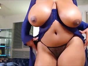 Hot black mega-bitch exposing her really fat natural boobs